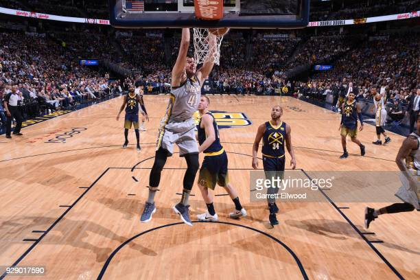 Ante Zizic of the Cleveland Cavaliers dunks the ball during the game against the Denver Nuggets on March 7 2018 at the Pepsi Center in Denver...