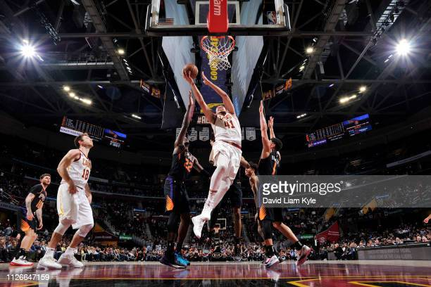 Ante Zizic of the Cleveland Cavaliers goes to the basket against the Phoenix Suns on February 21 2019 at Quicken Loans Arena in Cleveland Ohio NOTE...