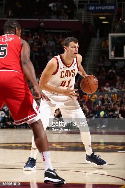 Ante Zizic of the Cleveland Cavaliers handles the ball against the Chicago Bulls during a preseason game on October 10 2017 at Quicken Loans Arena in...