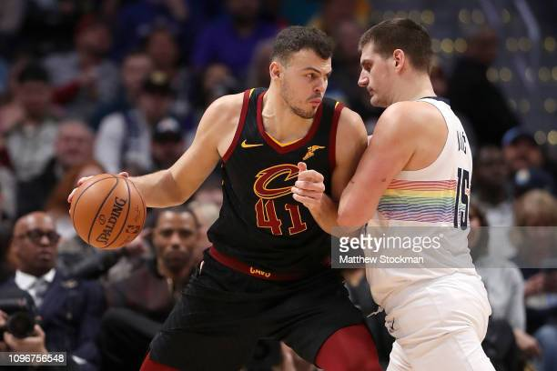 Ante Zizic of the Cleveland Cavaliers is guarded by Nikola Jokic of the Denver Nuggets in the first period at the Pepsi Center on January 19 2019 in...
