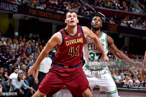 Ante Zizic of the Cleveland Cavaliers plays defense on Semi Ojeleye of the Boston Celtics during a preseason game on October 6 2018 at Quicken Loans...