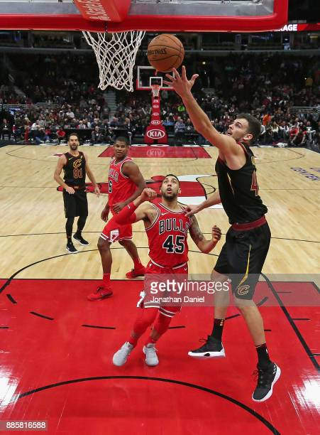Ante Zizic of the Cleveland Cavaliers puts up a shot over Denzel Valentine of the Chicago Bulls at the United Center on December 4 2017 in Chicago...