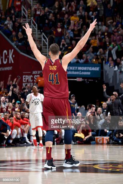 Ante Zizic of the Cleveland Cavaliers signals a made three pointer by a teammate against the Toronto Raptors on March 21 2018 at Quicken Loans Arena...