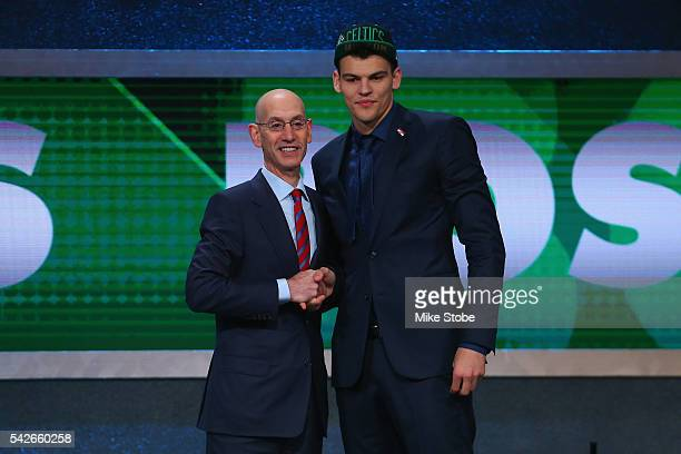 Ante Zizic shakes hands with Commissioner Adam Silver after being drafted 23rd overall by the Boston Celtics in the first round of the 2016 NBA Draft...