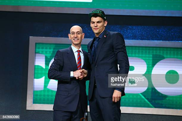 Ante Zizic shakes hands with NBA Commissioner Adam Silver after being selected number twenty three overall by the Boston Celtics during the 2016 NBA...