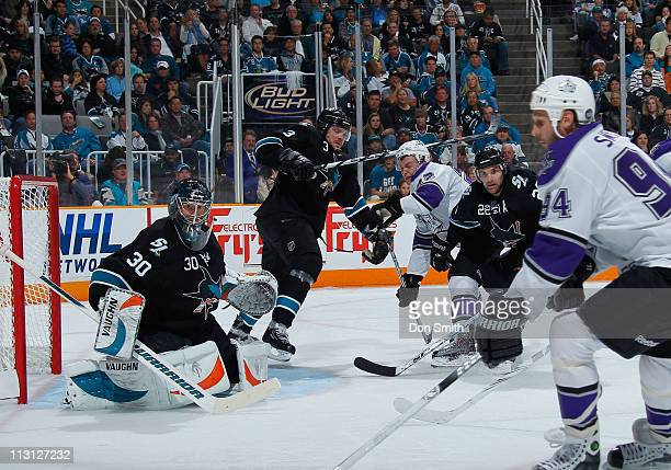 Antero Niittymaki, Douglas Murray and Dan Boyle of the San Jose Sharks defend the net against Ryan Smyth of the Los Angeles Kings in Game 5 of the...