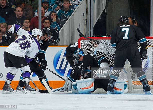 Antero Niittymaki, Niclas Wallin, Logan Couture and Ryane Clowe of the San Jose Sharks defend the net against Jarrett Stoll of the Los Angeles Kings...