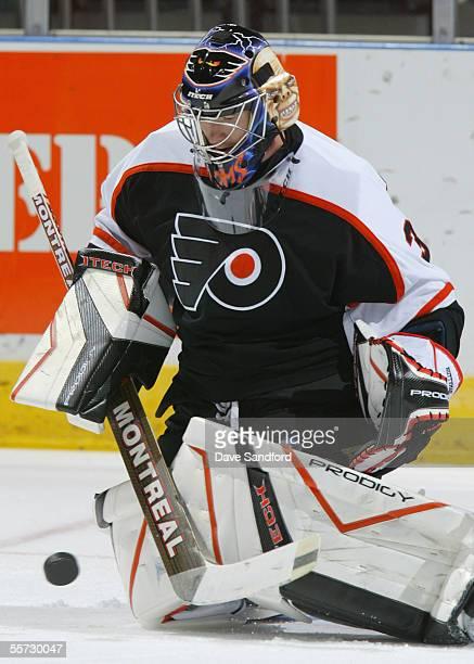 Antero Niittymaki of the Philadelphia Flyers makes a save during the NHL game against the Atlanta Thrashers at the John Labatt Centre September 17...