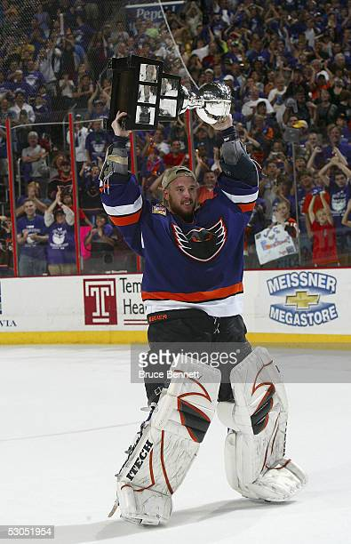 Antero Niittymaki of the Philadelphia Phantoms celebrates with the Calder Cup after the Phantoms defeated the Chicago Wolves 52 to sweep the series...