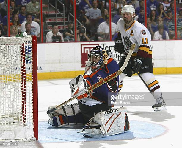Antero Niittymaki of the Philadelphia Phantoms makes the save on Steve Maltais of the Chicago Wolves as the Phantoms defeated the Wolves 52 to sweep...