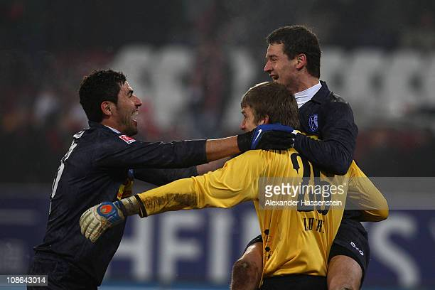 Anthar Yahia of Bochum celebrates with his team mates Andreas Luthe and Marcel Maltritz after the Second Bundesliga match between FC Augsburg and VfL...