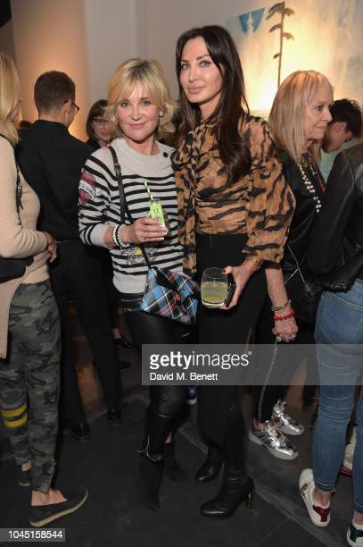 Anthea Turner and a guest attend the 21st Century Women VIP preview at Unit London Mayfair London on October 3 2018 in London England