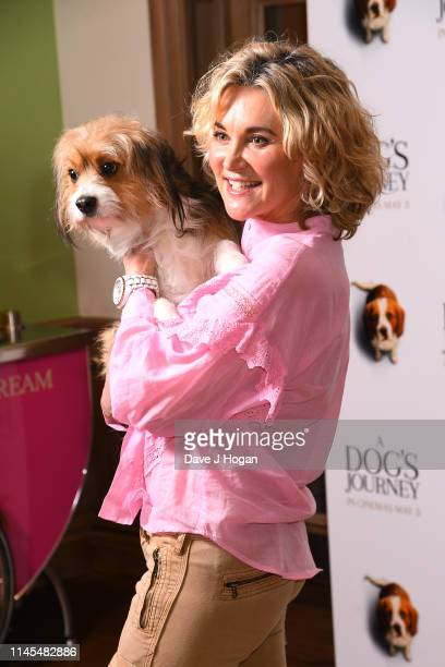 Anthea Turner poses with Bailey the dog as she attends a gala screening of A Dog's Journey at The Soho Hotel on April 27 2019 in London England