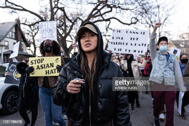 """Anthea Yur leads protesters in chants during the """"Asian Solidarity March"""" rally against anti-Asian hate in response to recent anti-Asian crime on..."""