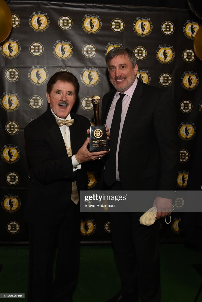 Anthem singer for 42 years, Rene Rancourt poses for a photo with Cam Neely, President of the Boston Bruins before the game against the Florida Panthers at the TD Garden on April 8, 2018 in Boston, Massachusetts.
