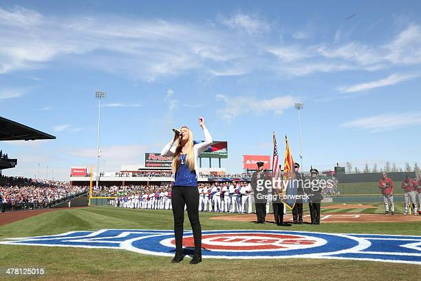 Anthem singer Michelle Moyer performs prior to the inaugural game at Cubs Park between the Chicago Cubs and the Arizona Diamondbacks on February 27...