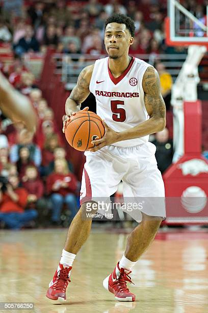 Anthlon Bell of the Arkansas Razorbacks looks to make a pass during a game against the Mississippi State Bulldogs at Bud Walton Arena on January 9...