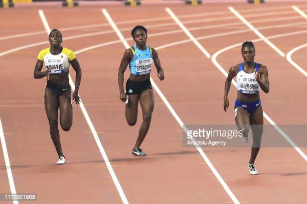 Anthonique Strachan of the Bahamas and Dina AsherSmith of Britain compete during the women's 200m semi finals at the IAAF World Athletics...