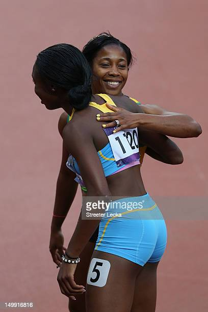 Anthonique Strachan of the Bahamas and Veronica CampbellBrown of Jamaica embrace after the Women's 200m heat on Day 10 of the London 2012 Olympic...
