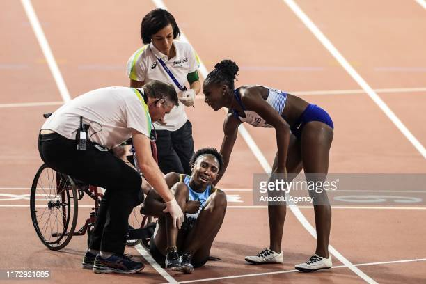 Anthonique Strachan of the Bahamas receives medical assistance during the women's 200m semi finals at the IAAF World Athletics Championships 2019 at...