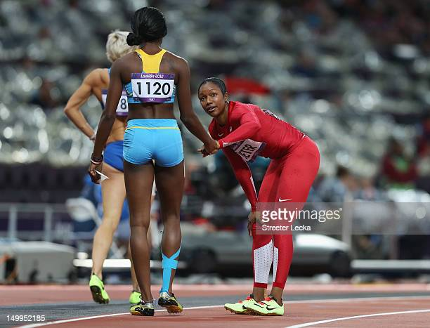 Anthonique Strachan of the Bahamas shakes hands with Carmelita Jeter of the United States after competing in the Women's 200m Semifinals on Day 11 of...