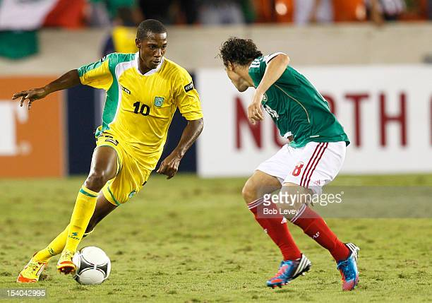 Anthony Abrams of Guyana moves the ball on Angel Reyna of Mexico at BBVA Compass Stadium on October 12 2012 in Houston Texas Mexico defeated Guyana 50
