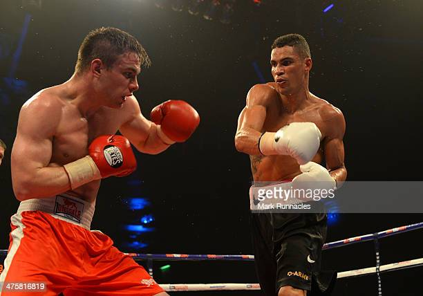 Anthony Agogo and Greg O'Neil clash during an undercard bout at the WBO World Lightweight Championship Boxing match at the Glasgow SECC on March 1...