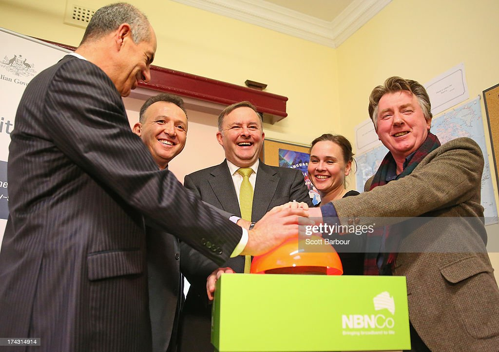 Anthony Albanese (C), Deputy Prime Minister of Australia pushes a large button to switch on the NBN fibre network to an adtional 2,600 homes and businesses in Brunswick at the Brunswick Digital Hub on July 24, 2013 in Melbourne, Australia. The national broadband network is being rolled out accross Australia, and is to provide over 93% of Australian homes and business with access to a fibre optic network. As the 2013 Australian federal election approaches and infrastructure remains a major concern of voters, the Labor party continues to push the power of their fibre direct to the home plan with the Liberal party pushing what it claims is a more cost-effective plan using existing copper and new optical fibre.