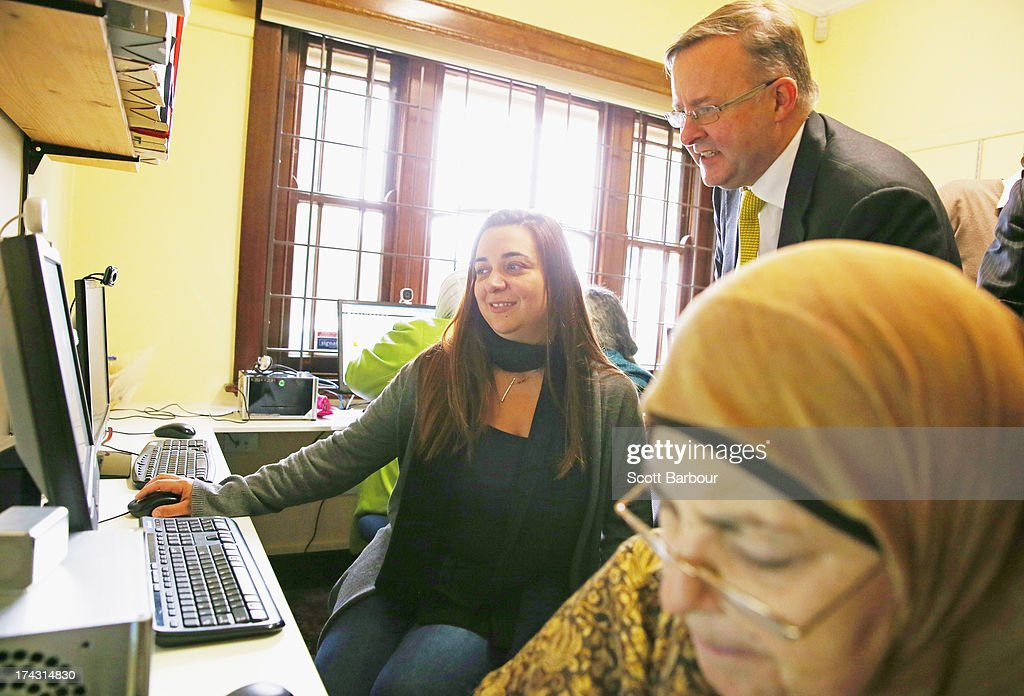 Anthony Albanese, Deputy Prime Minister of Australia watches as locals use computers on the NBN as he switches on the NBN fibre network to an adtional 2,600 homes and businesses in Brunswick at the Brunswick Digital Hub on July 24, 2013 in Melbourne, Australia. The national broadband network is being rolled out accross Australia, and is to provide over 93% of Australian homes and business with access to a fibre optic network. As the 2013 Australian federal election approaches and infrastructure remains a major concern of voters, the Labor party continues to push the power of their fibre direct to the home plan with the Liberal party pushing what it claims is a more cost-effective plan using existing copper and new optical fibre.