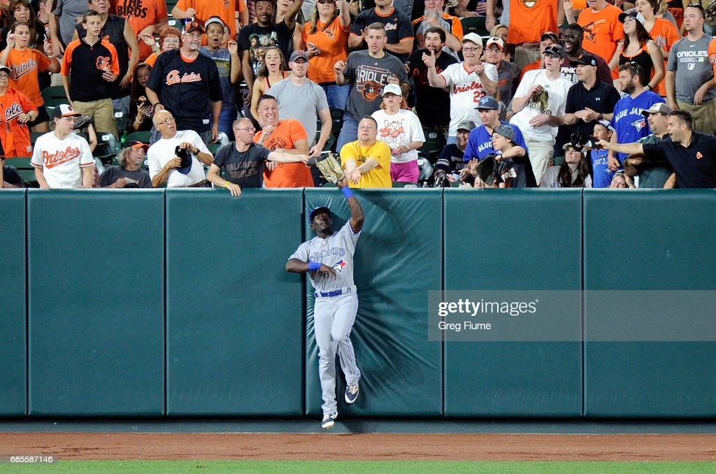 Anthony Alford #30 of the Toronto Blue Jays, in his MLB debut, catches a ball hit by J.J. Hardy #2 (not pictured) of the Baltimore Orioles in the sixth inning at Oriole Park at Camden Yards on May 19, 2017 in Baltimore, Maryland.