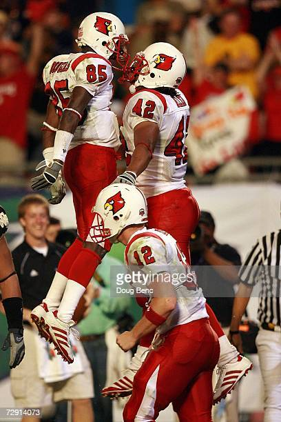 Anthony Allen Harry Douglas and Brian Brohm of the Louisville Cardinals celebrate a touchdown in the second quarter against the Wake Forest Demon...