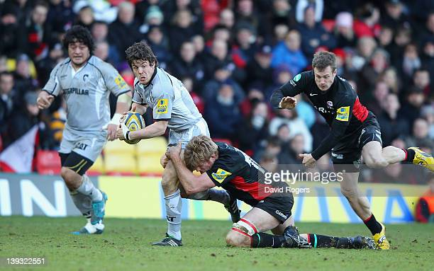 Anthony Allen of Leicester is tackled by Hugh Vyvyan during the Aviva Premiership match between Saracens and Leicester Tigers at Vicarage Road on...