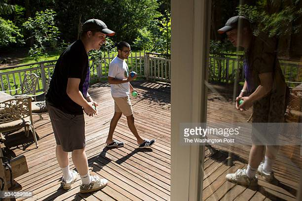 Anthony and Nikhil wait for Dakota the house dog at reSTART a rehabilitation center for digital media addiction in Fall City Washington on May 13...