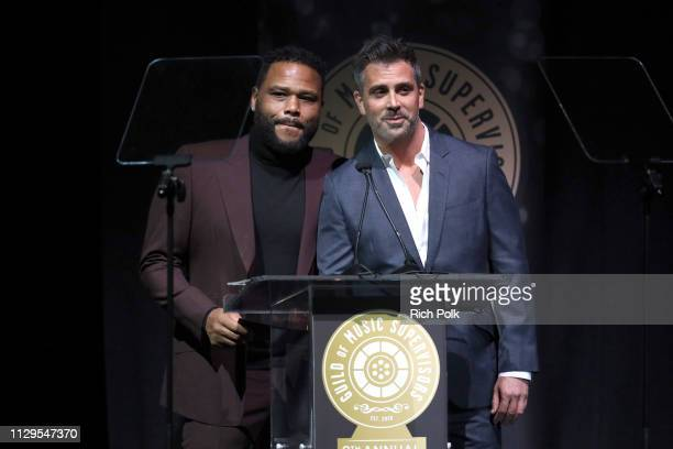 Anthony Anderson and Alex Hackford speak onstage during the 9th Annual Guild of Music Supervisors Awards on February 13 2019 at The Theatre at Ace...