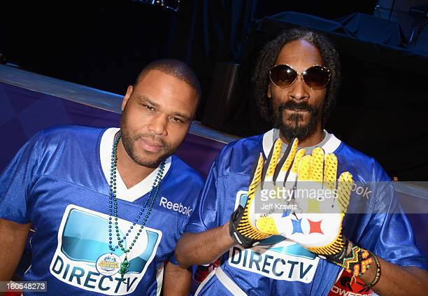 Anthony Anderson and Snoop Lion attend DIRECTV'S 7th Annual Celebrity Beach Bowl at DTV SuperFan Stadium at Mardi Gras World on February 2 2013 in...