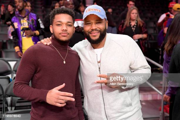 Anthony Anderson and son Nathan Anderson attend a basketball game between the Los Angeles Lakers and the Los Angeles Clippers at Staples Center on...