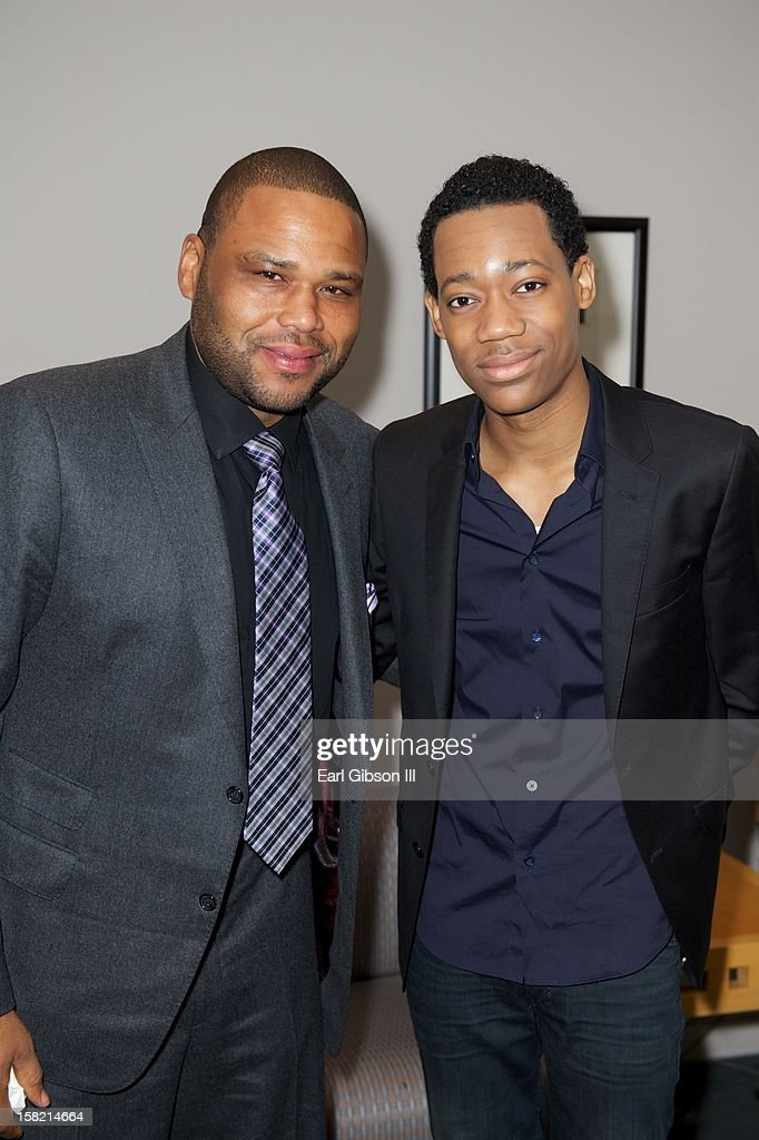 Anthony Anderson and Tyler James Williams pose for a photo at the 44th NAACP Image Awards Press Conference at The Paley Center for Media on December 11, 2012 in Beverly Hills, California.