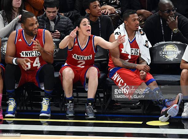 Anthony Anderson Sarah Silverman and Nick Cannon watch during the Sprite NBA AllStar Celebrity Game at Madison Square Garden in New York February 13...