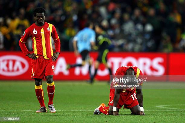 Anthony Annan and Stephen Appiah of Ghana show their dejection as they lose a penalty shoot out during the 2010 FIFA World Cup South Africa Quarter...
