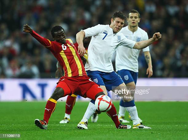 Anthony Annan of Ghana battles for the ball with James Milner of England during the international friendly match between England and Ghana at Wembley...