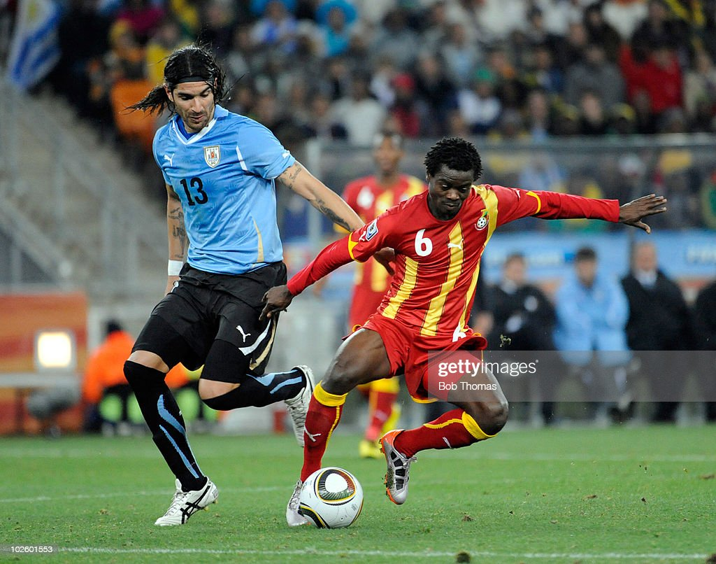 Anthony Annan of Ghana (R) challenged by Sebastian Abreu of Uruguay during the 2010 FIFA World Cup South Africa Quarter Final match between Uruguay and Ghana at the Soccer City stadium on July 2, 2010 in Johannesburg, South Africa. The match ended 1-1 after extra-time. Uruguay won 4-2 on penalties.