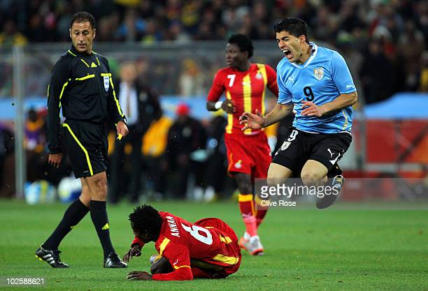 Anthony Annan of Ghana clashes with Luis Suarez of Uruguay during the 2010 FIFA World Cup South Africa Quarter Final match between Uruguay and Ghana...