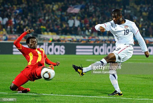 Anthony Annan of Ghana defends against a shot from Maurice Edu of the United States during the 2010 FIFA World Cup South Africa Round of Sixteen...