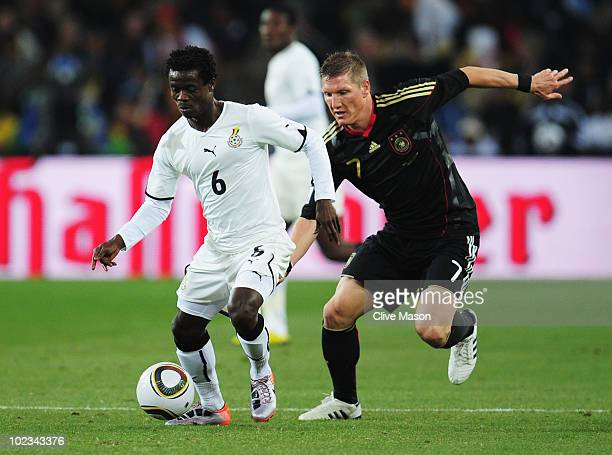 Anthony Annan of Ghana is pursued by Bastian Schweinsteiger of Germany during the 2010 FIFA World Cup South Africa Group D match between Ghana and...