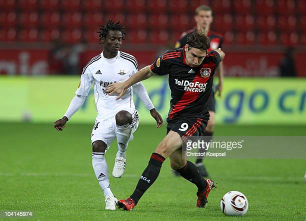 Anthony Annan of Rosenborg challenges Patrick Helmes of Leverkusen during the UEFA Europa League group B match between Bayer Leverkusen and Rosenborg...