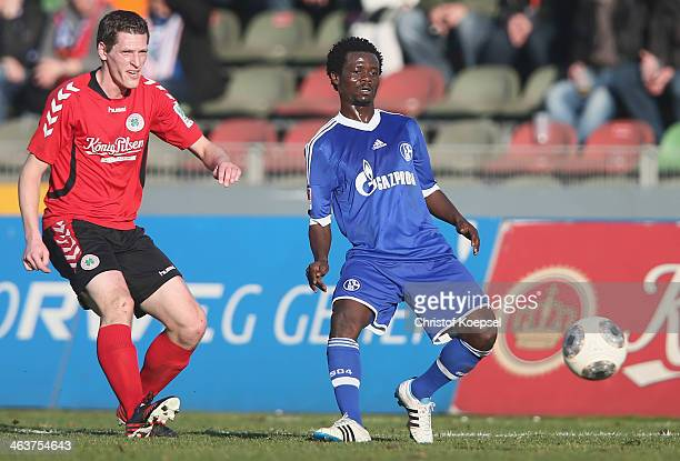 Anthony Annan of Schalke challenges Robert Flessers of Oberhausen during the friendly match between RW Oberhausen and FC Schalke 04 at Niederrhein...