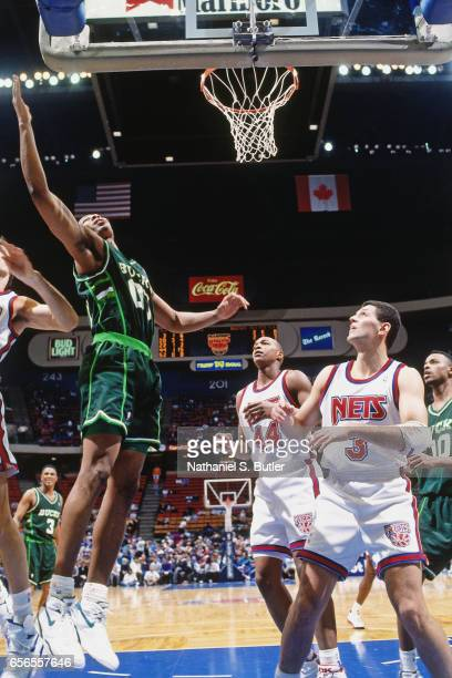 Anthony Avent of the Milwaukee Bucks rebounds against the New Jersey Nets during a game played circa 1993 at the Brendan Byrne Arena in East...
