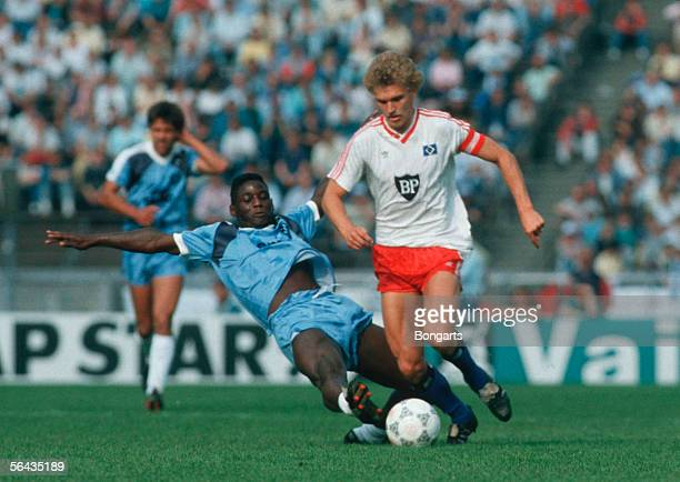 Anthony Baffoe of Stuttgarter Kickers and Thomas van Heesen of Hamburger SV in action during the DFB German Cup final match between Hamburger SV and...
