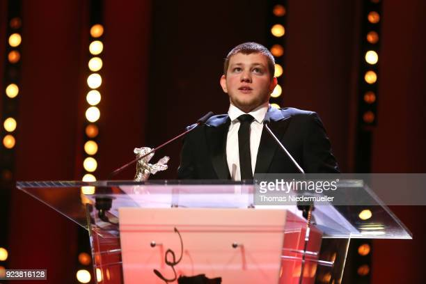 Anthony Bajon receives the Silver Bear for Best Actor for 'The Prayer' on stage at the closing ceremony during the 68th Berlinale International Film...