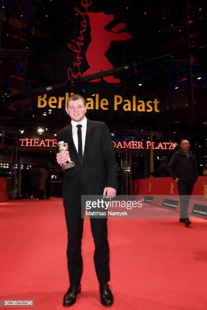 Anthony Bajon winner of the Silver Bear for Best Actor for 'The Prayer' poses with his award after the closing ceremony during the 68th Berlinale...